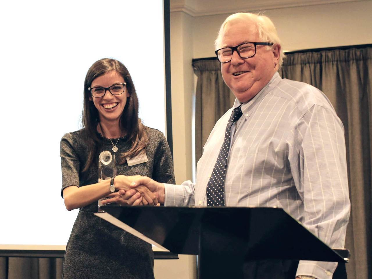 Isabella Giovinazzo receiving the Best Poster Prize trophy from Brian Murphy, Chairman of the Britest Board at Britest Day 2018, which took place on Thursday 18th October 2018 in Warrington, UK.